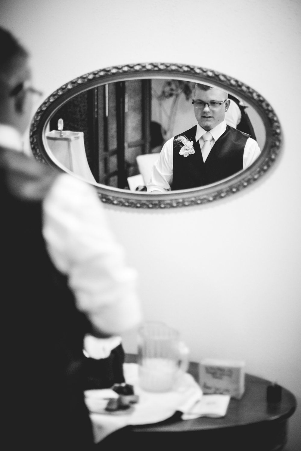 Groom getting ready. Photographed by JMGant Photography.