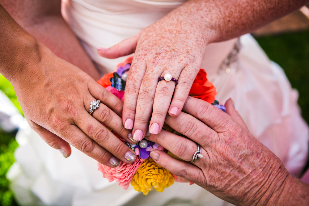 Three generations of wedding rings. Photographed by JMGant Photography.
