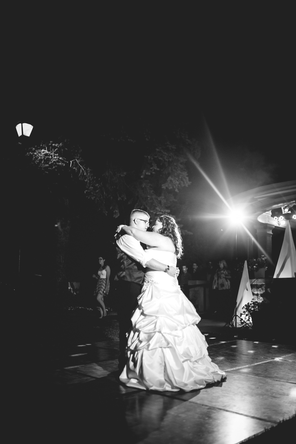 Bride and groom dancing in the dark. Photographed by JMGant Photography.