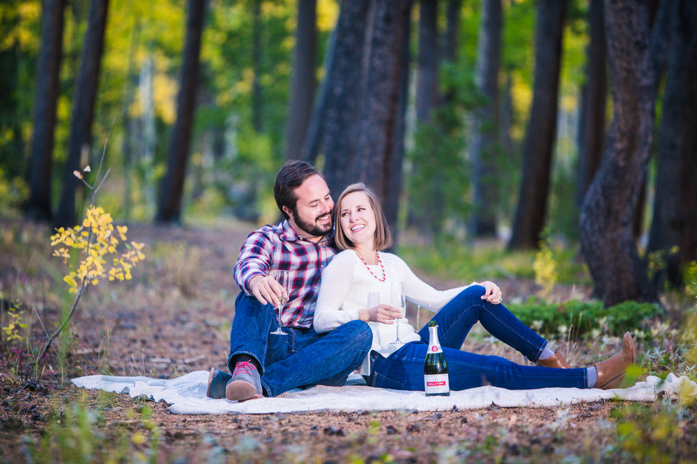 Champagne picnic during fall engagement pictures. Photos take by JMGant Photography.