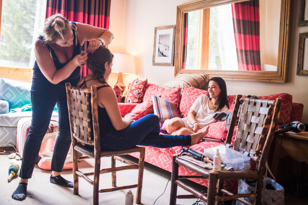 Bridal party getting ready for their Vail Colorado Wedding photographed by JMGant Photography.