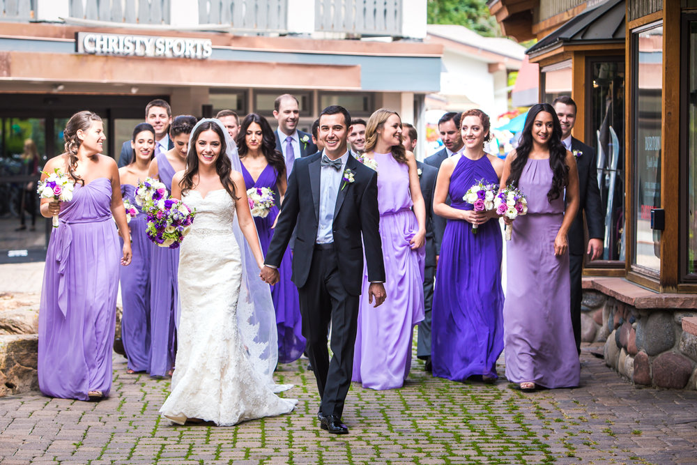 Bridal party walking through Vail Village to their Vail Colorado Wedding photographed by JMGant Photography.