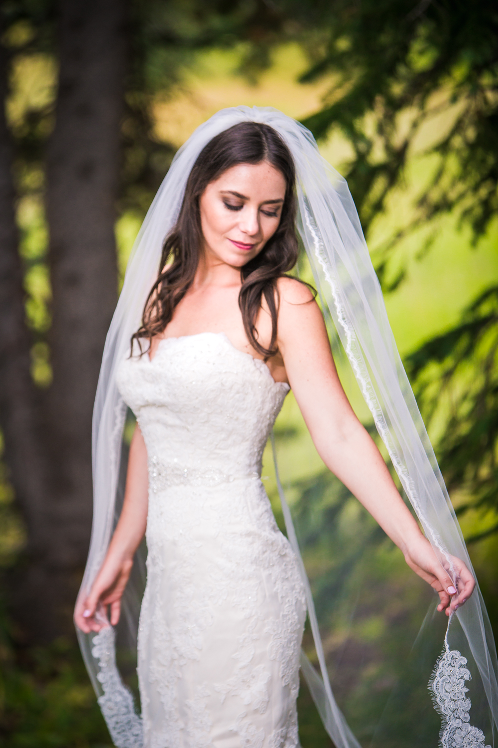 The bride with her long Veil at the 10th Resturant.Vail Colorado Wedding photographed by JMGant Photography.