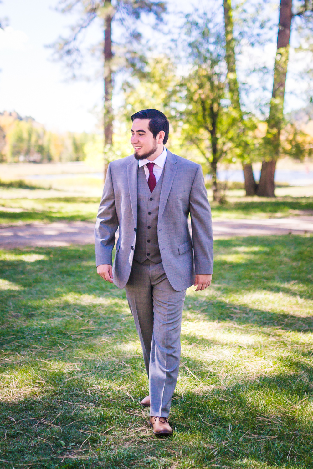 Groom in gray suite by JMGant Photography.