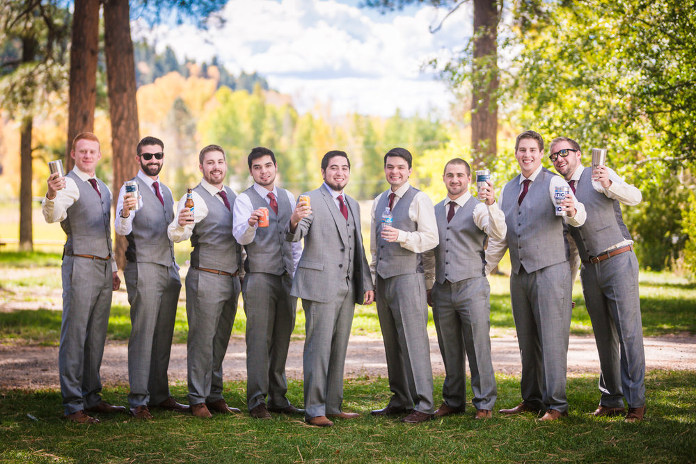 Groomsmen in grey suites by JMGant Photography.