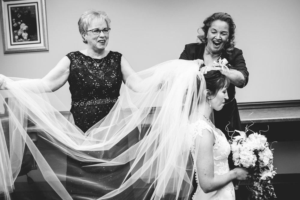 Mothers helping the bride get her vail on  by JMGant Photography.