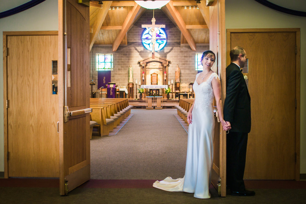 Bride and groom pray  by JMGant Photography.