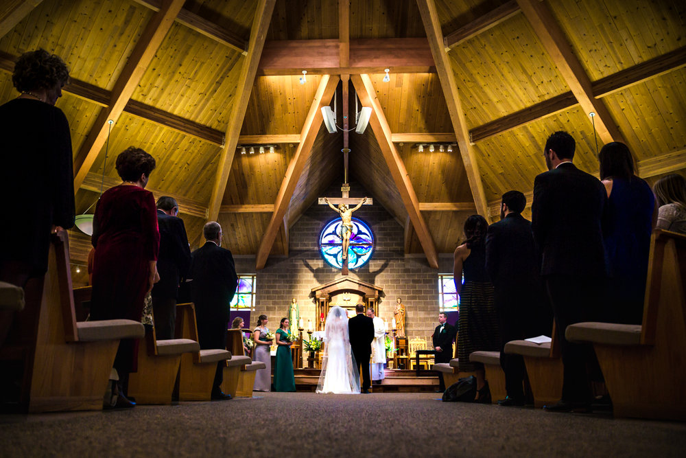 Catholic wedding  by JMGant Photography.