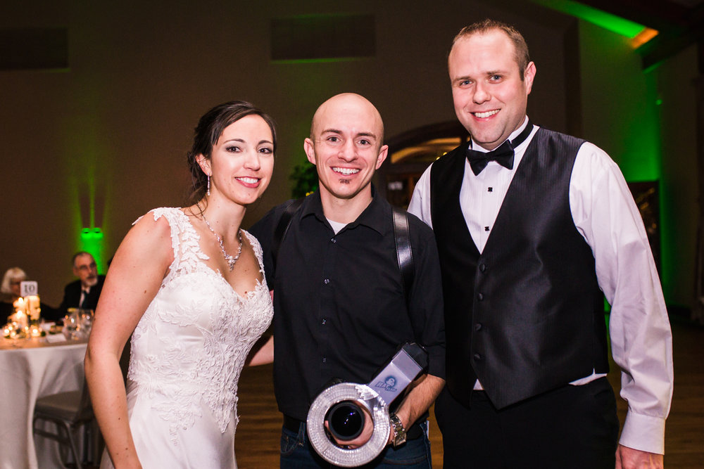 Jared M. Gant of JMGant Photogrpahy with bride and groom.