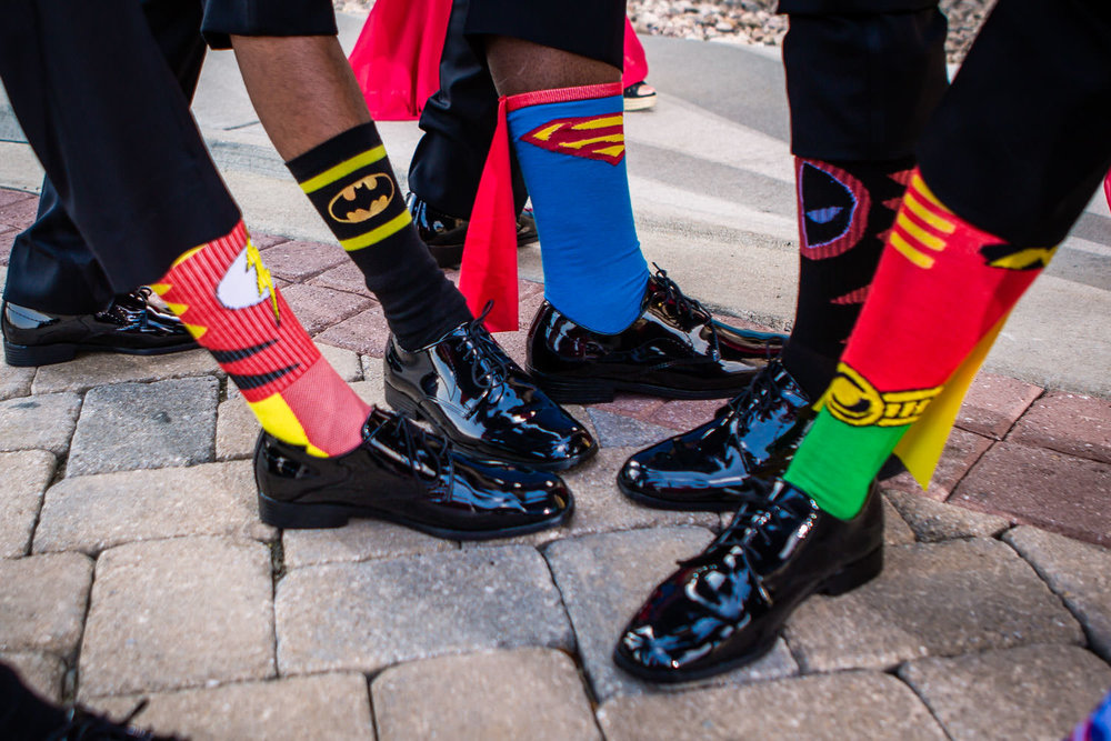 Blackstone Country Club wedding by JMGant Photography. The groomsmen and their super hero socks!