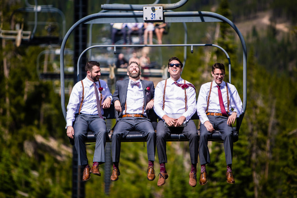 Groomsment riding the lift up Winter Park to The Lodge at Sunspot
