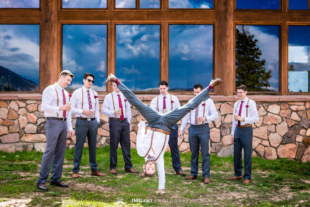 Groom doing a handstand! Wedding party photos at Winter Park, mountain wedding at the Lodge at Sunspot, photographed by JMGant Photography