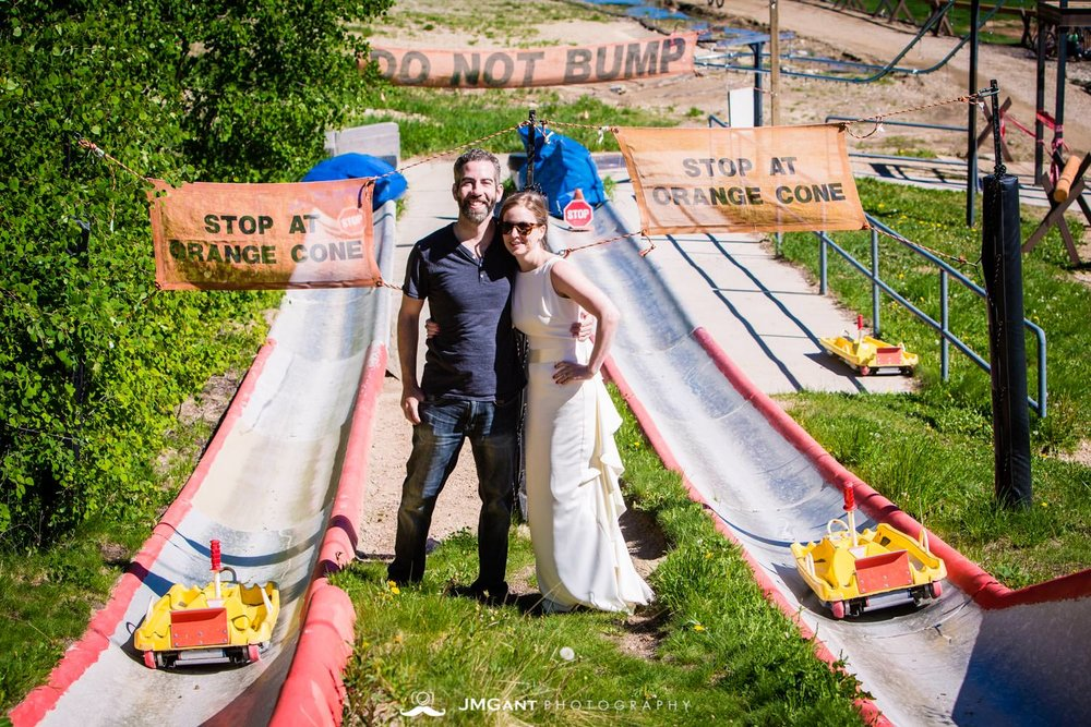 Bride and groom riding down the Winter Park Alpine Slide.