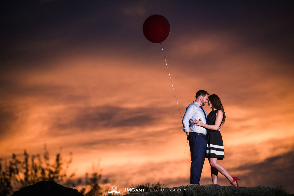 Incredibly colorful sunset at Rocky Mountain National Park during gorgeous Engagement Photography by JMGant Photography.