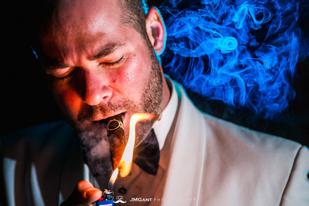 Vail Colorado Wedding | Smoking cigars | Colorado wedding photographer | © JMGant Photography | http://www.jmgantphotography.com/