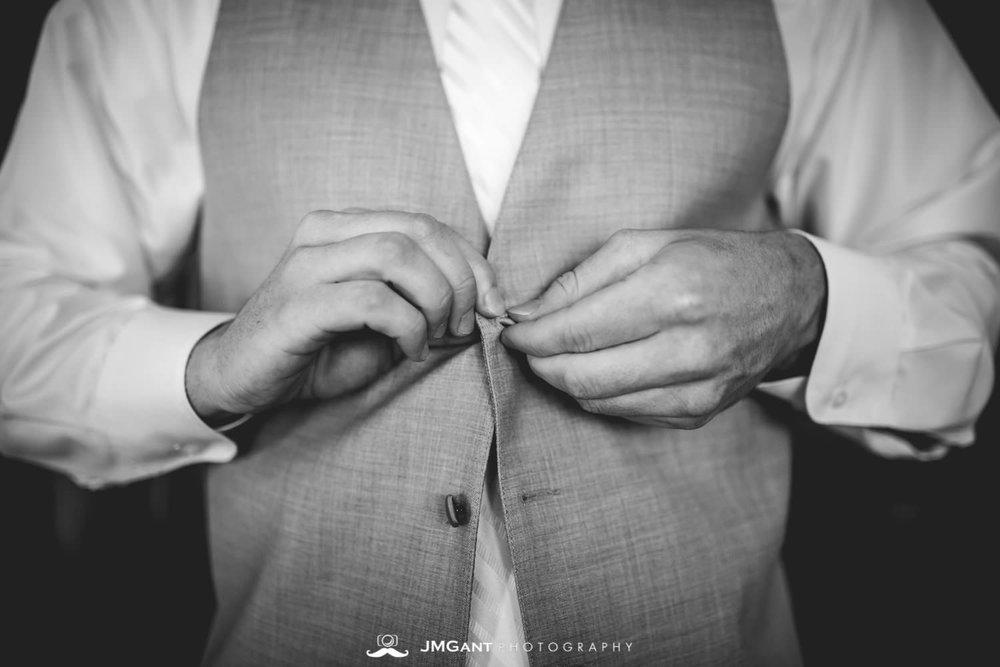 Platte River Fort Wedding | Groom getting ready | Greeley Colorado wedding photographer | © JMGant Photography | http://www.jmgantphotography.com/