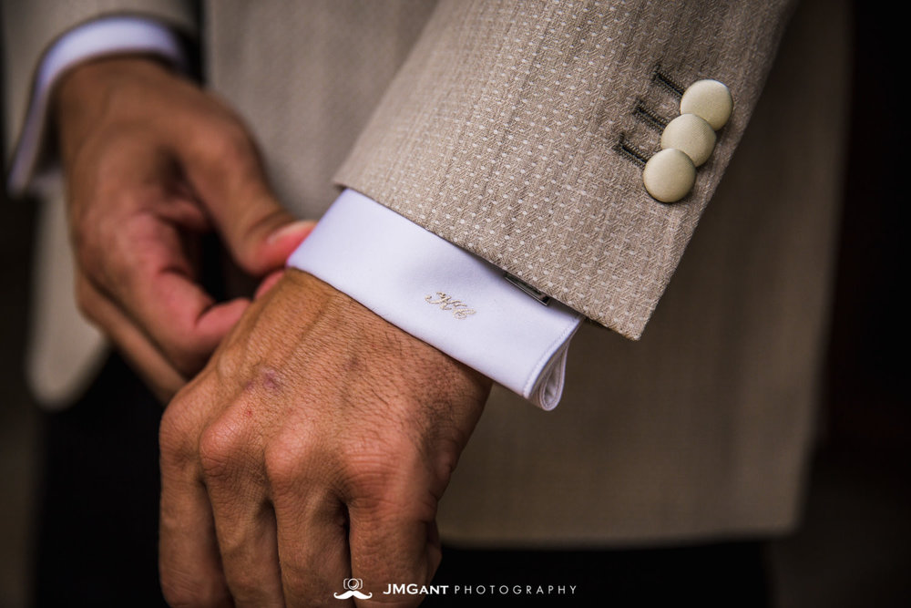 Denver Colorado Wedding | Groom getting dressed | Colorado wedding photographer | © JMGant Photography | http://www.jmgantphotography.com/
