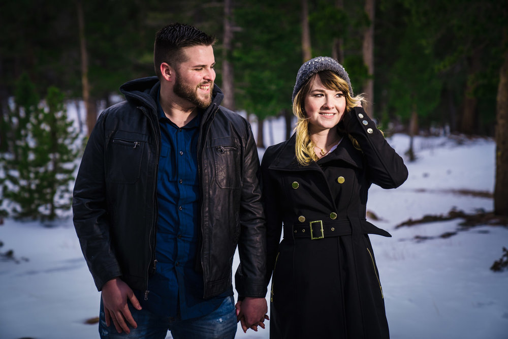 Snowy Estes Park Colorado engagement photos taken at Lily Lake in Rocky Mountain National. Photographed by JMGant Photography.