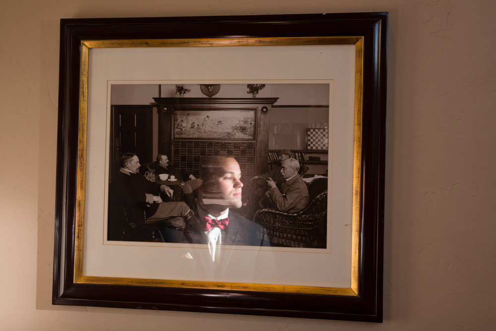Creative reflective photo of groom in groom suite at Blackstone Country Club. Photograph by JMGant Photography.