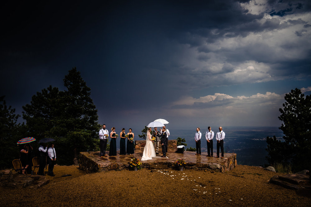 Rainy ceremony at Sunrise Amphitheater by wedding photographer, JMGant Photography