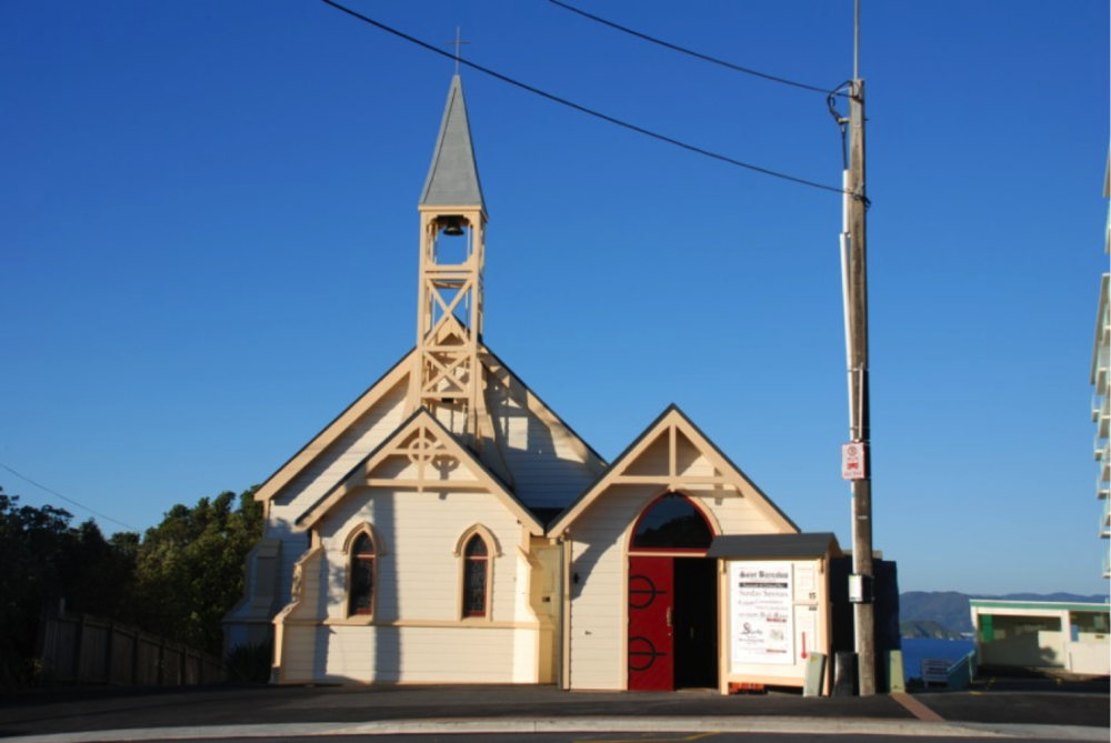 Oriental Bay is bordered by two churches of different denominations. At one end of the bay the spire of S. Barnabas Anglican Church rises. At the city-end stands the much larger bulk of S. Gerard's Catholic Church and Monastery.