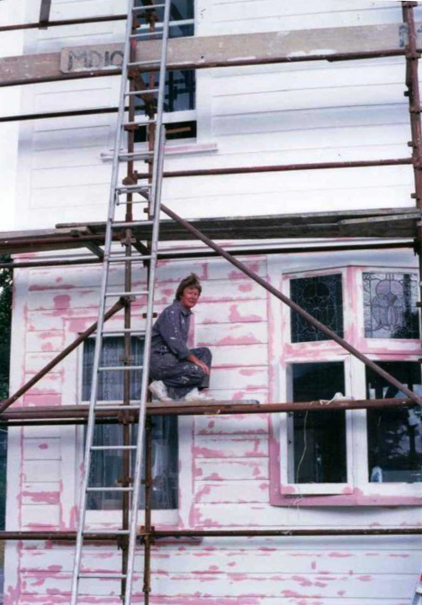Dorothy, painting their house — both are great do-it-yourselfers