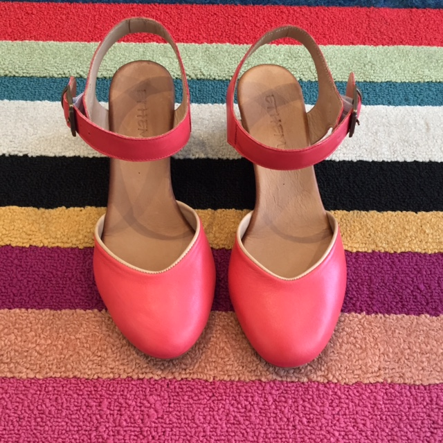 Add a bright pop of color to your outfit with these cute wedges by Ethem.