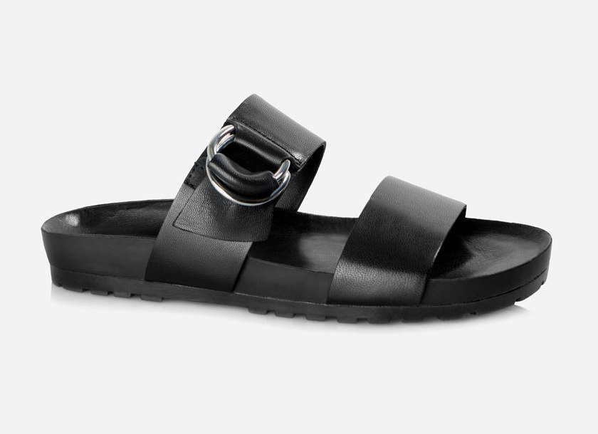 Thick straps and a sliver buckle detail lend an edgy minimalism to these cushy slip-in sandals.