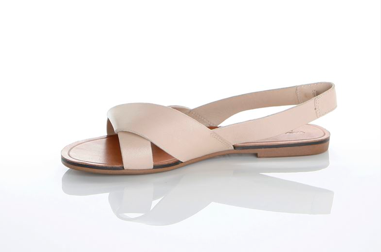 Sophisticated simplicity.  Clean lines and delicate crisscrossing  leather bring a uniquely modern and feminine feel to these slingback sandals.