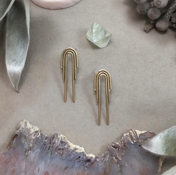 Drop Arch Studs- feature delicate arch designs cast in bronze.