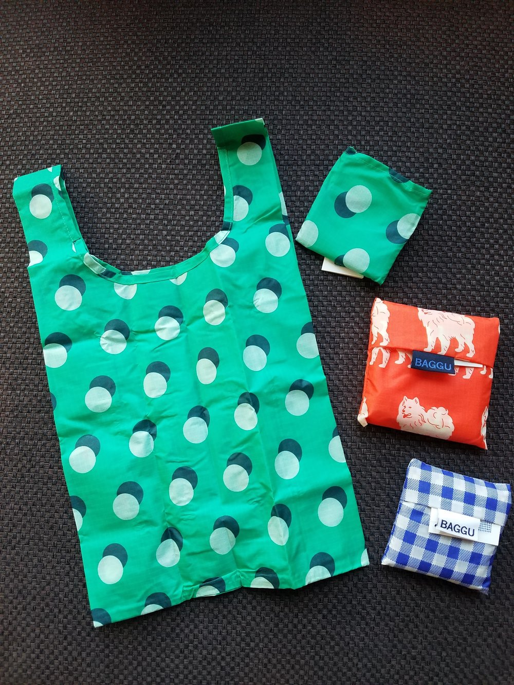 Reusable bags in two different sizes. Machine washable and made of ripstop nylon. Lots of colors and patterns available. Standard Baggu is $10 and the Baby Baggu is $8. *Open bag in picture is the Baby Baggu