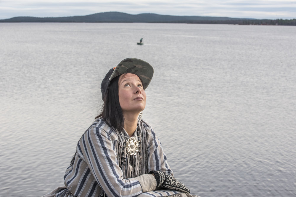 Sámi activist Jenni Laiti listens to a crow sing at village of Inari.  For HS 2016.