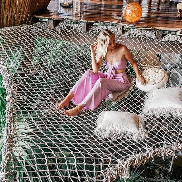 We caught mermaid @patigiemza in @calotulum wearing our Sugar Pants and Bardot Bandeau in Lavender 🦎 #calotulum #bamboosilk  #tulumdesigner #tulumstyle #tulumfashion #azulik #tulum #beach #treehouse #resort