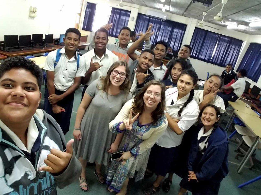 Kortney and Dixie with students they taught in Fiji