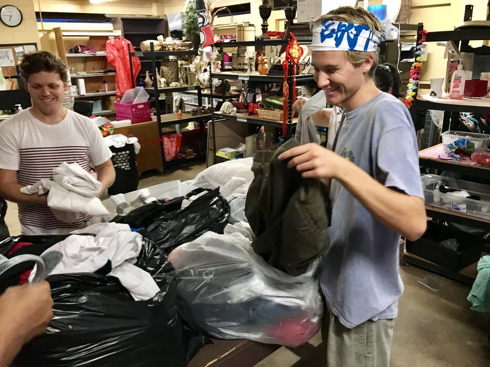 Scott and James sorting clothes.