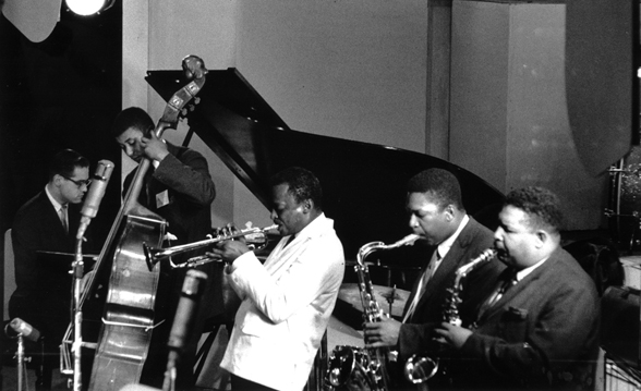 John Coltrane with Miles Davis. Masters of their tools, including of other musicians