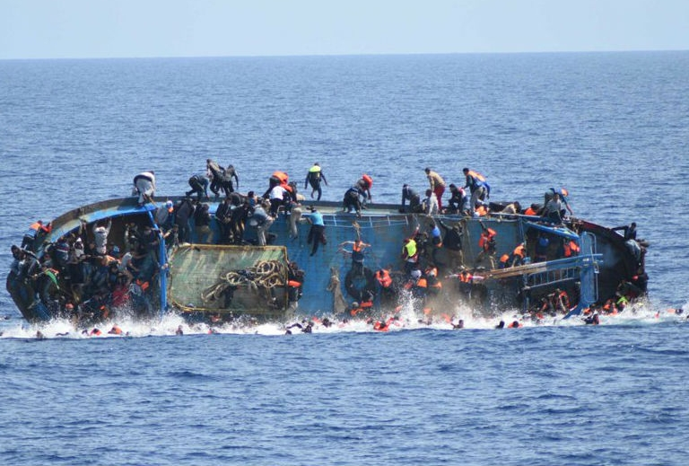 A refugee boat capsizes off the Libyan coast