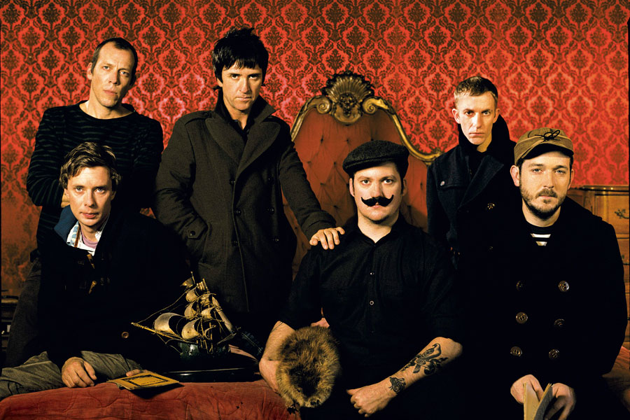 Modest Mouse with Johnny Marr (second from left, standing)
