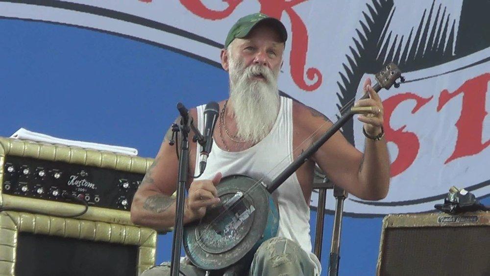 Seasick Steve with his hub cap and broomstick guitar
