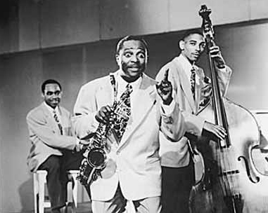 Louis Jordan with two of his Tympany Five