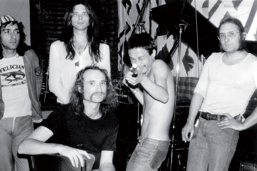 Can with bass player and co-founder Holger Czukay (seated).