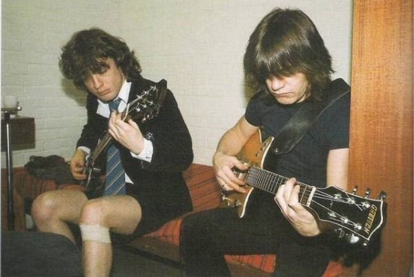 Brothers Angus and Malcolm (right) AC/DC's founders, practising in their younger days