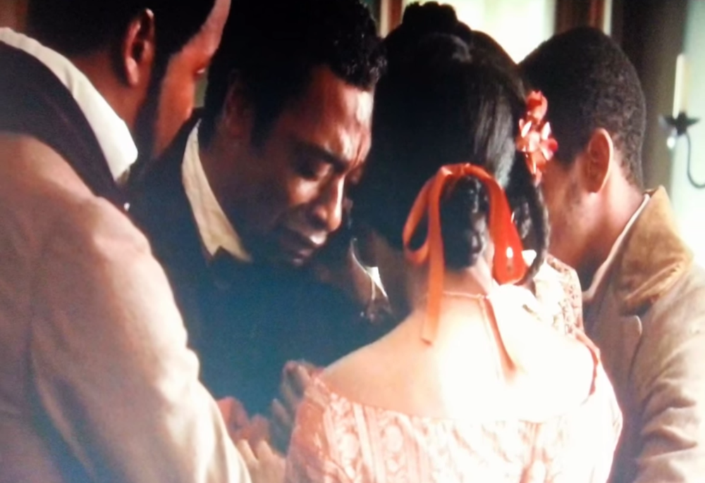 A tender moment in the powerful 12 Years A Slave (2013)