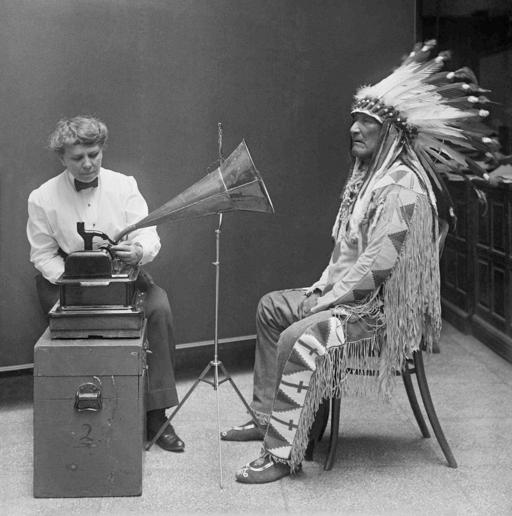 Ethnomusicologist Frances Densmore recording the music of a Blackfoot chief onto a phonograph, 1916.