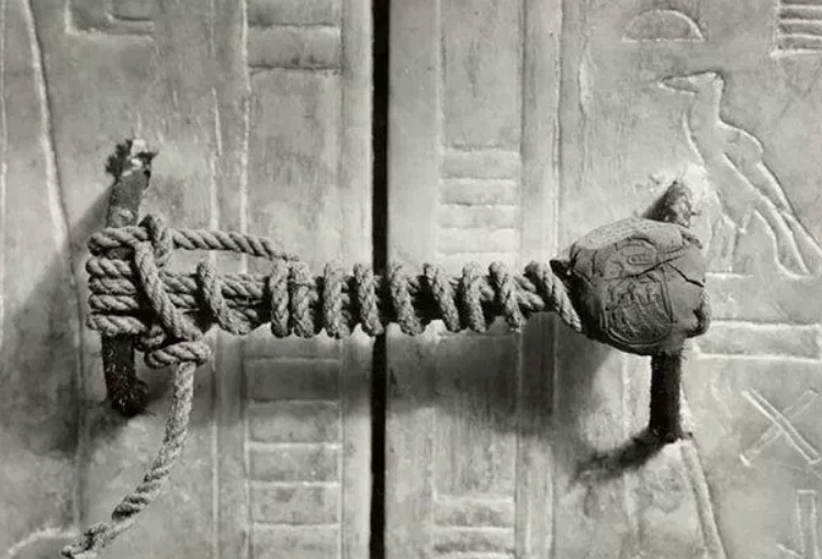 Howard Carter, the British archaeologist who discovered the mysterious and intact tomb of Tutankhamun in 1922. This photograph shows unbroken seal of Tutankhamun's Tomb, untouched for 3,245 years.