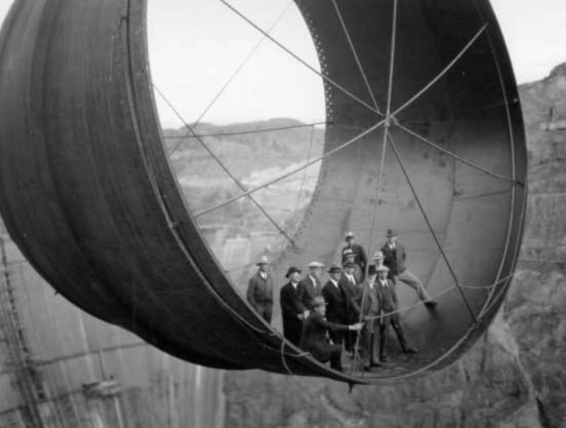 A massive section of pipe is moved into part of the Hoover Dam in Black Canyon of the Colorado River., sometime during the project from 1931 until 1936