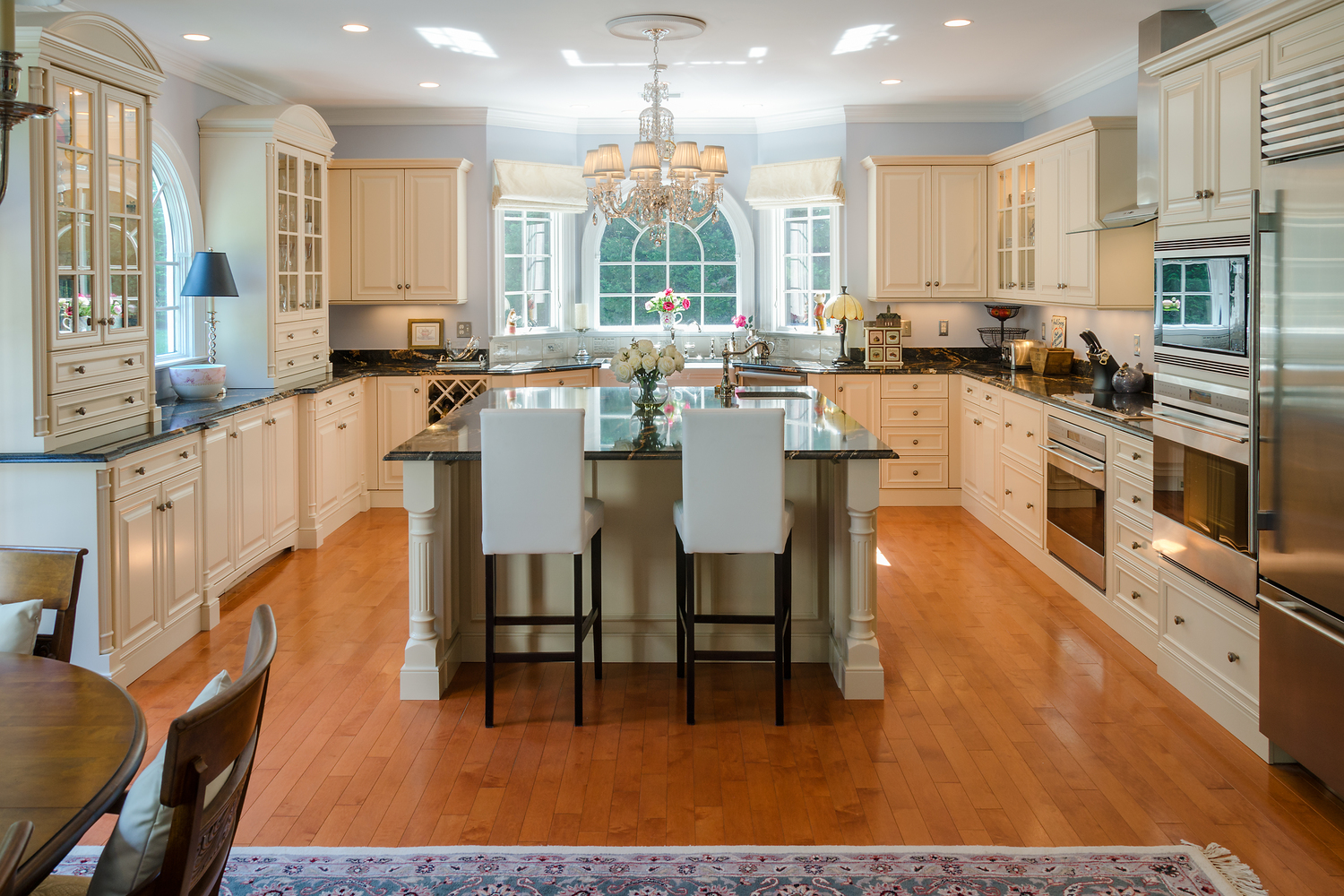 traditional kitchen overlooking the golf course u2014 custom kitchens