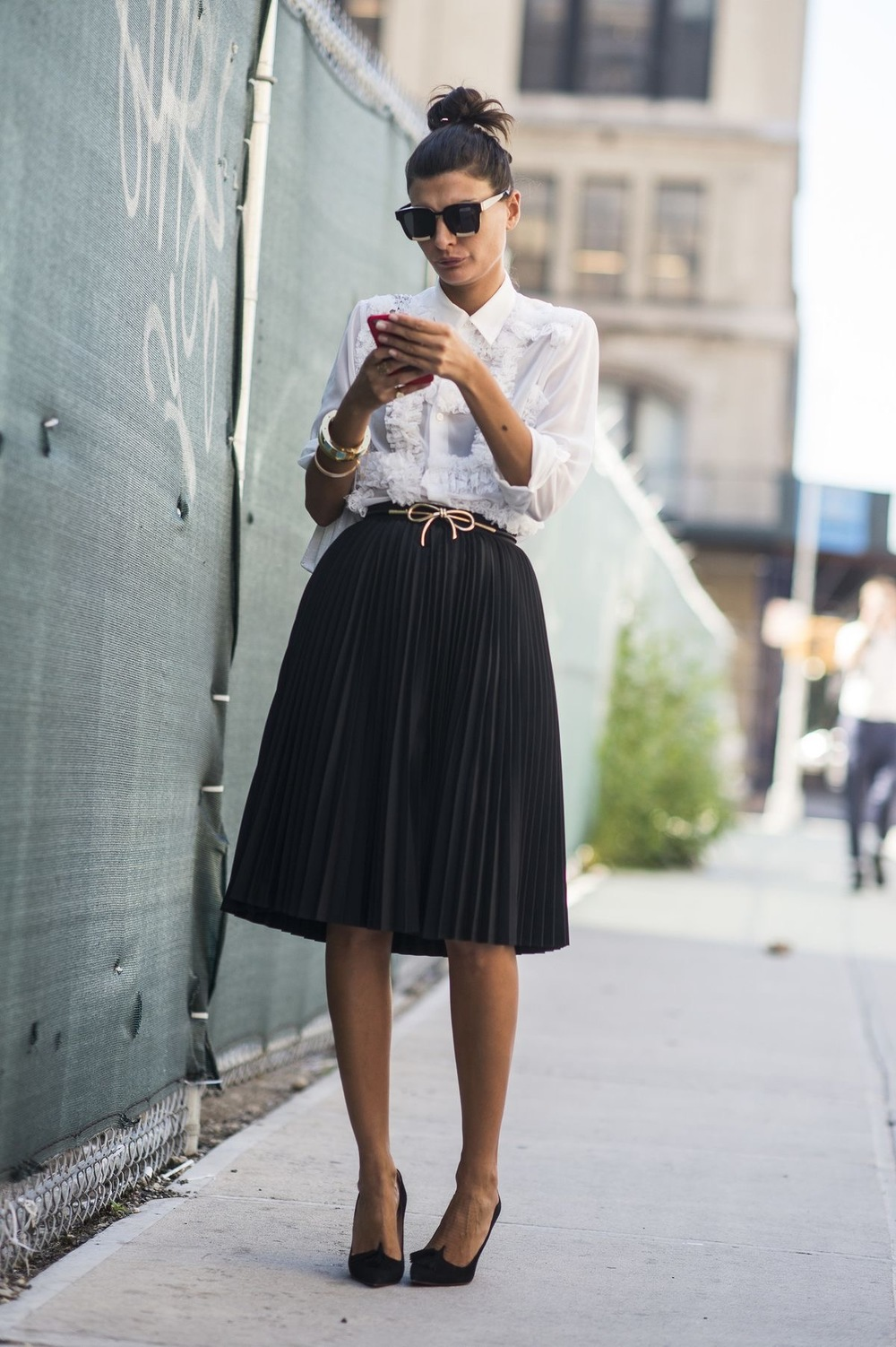 White button downs and black skirts are workplace wardrobe essentials. Spice these combos up with statement jewelry, shoes or handbags.