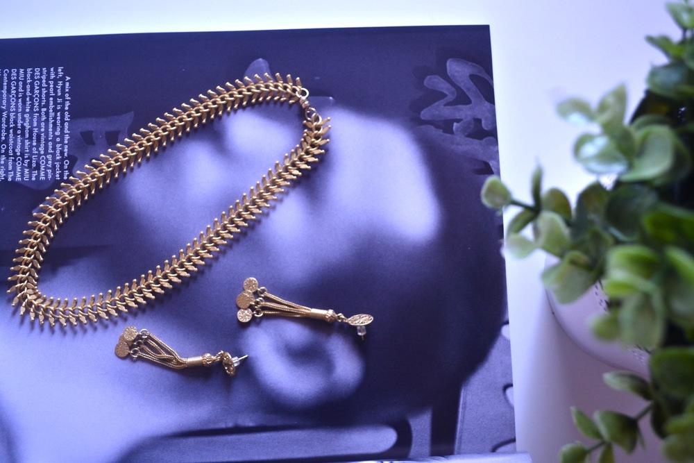 Pictured:Kantara Fish Bone choker,Mindi Gold Snake Chain Tassel Earrings