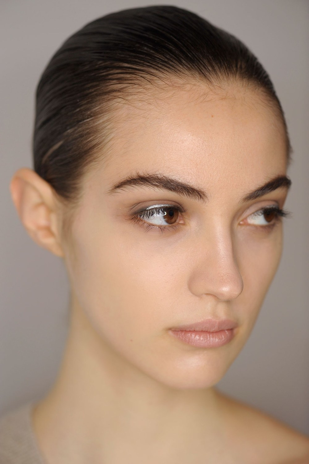 Jil Sander‎ - Lisa Eldridge kept models' skin fresh at Jil Sander‎, with grey-lined eyes offset by a flash of silver.